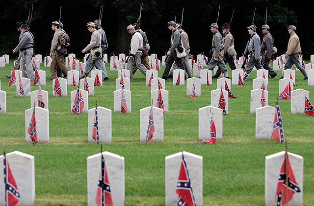 confederate gravestones with soldiers marching in background