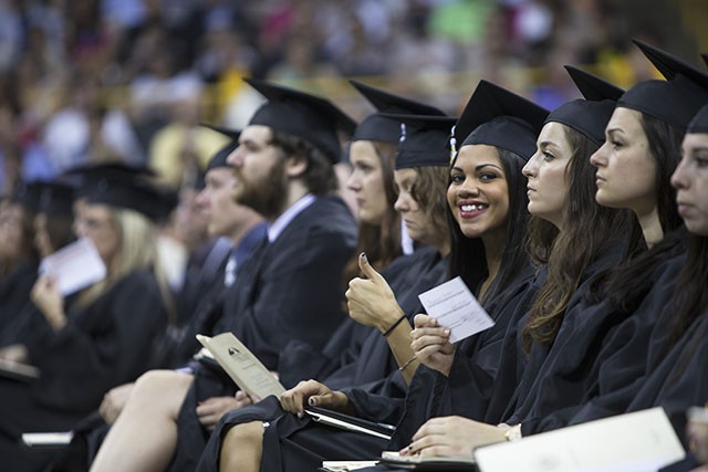 Graduates in caps and gowns at commencement ceremony