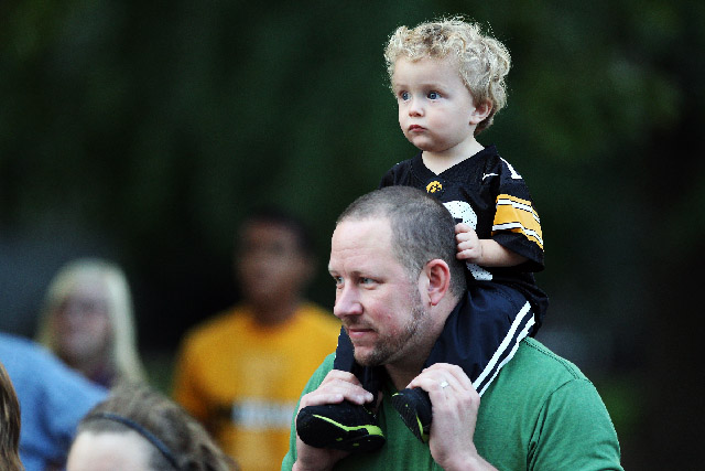Dad with young son sitting on his shoulders