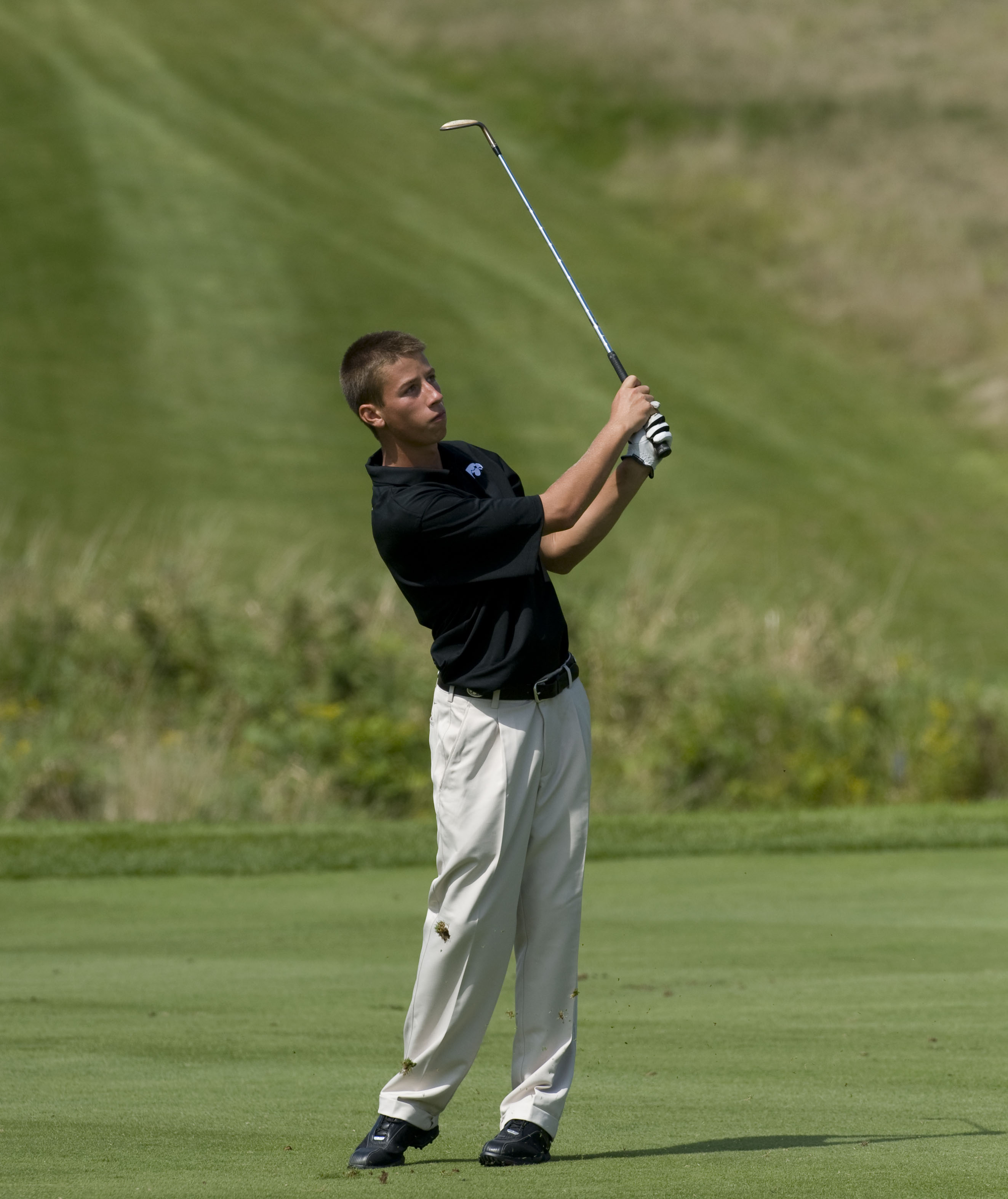 Vince India golfing at Iowa