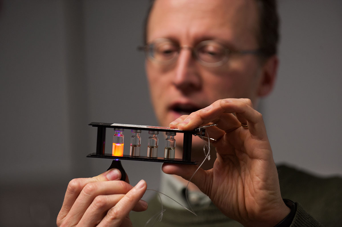 John Prineas, UI associate professor of physics and astronomy, demonstrates a fan powered by light from a flashlight illuminating a semiconductor solar cell