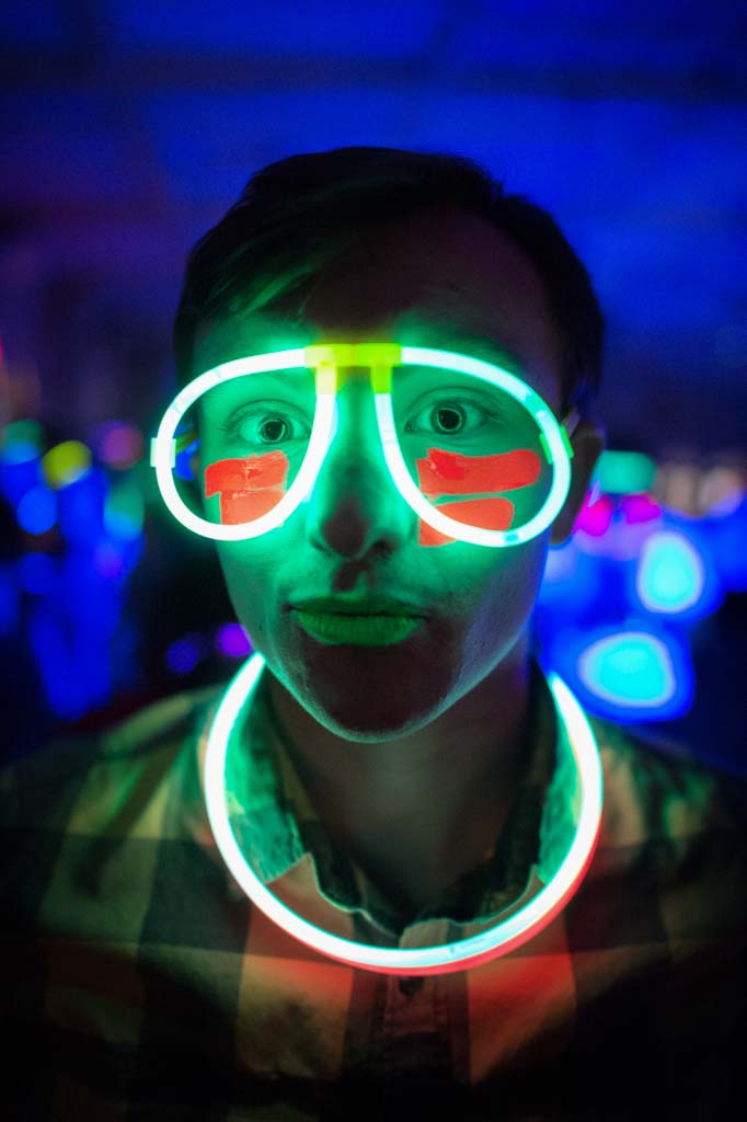 Man wearing glow stick glasses and necklace