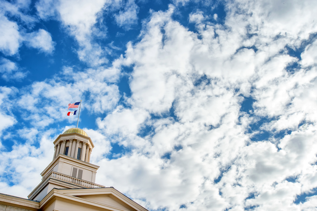 Old Capitol down with mix of clouds and blue sky above it