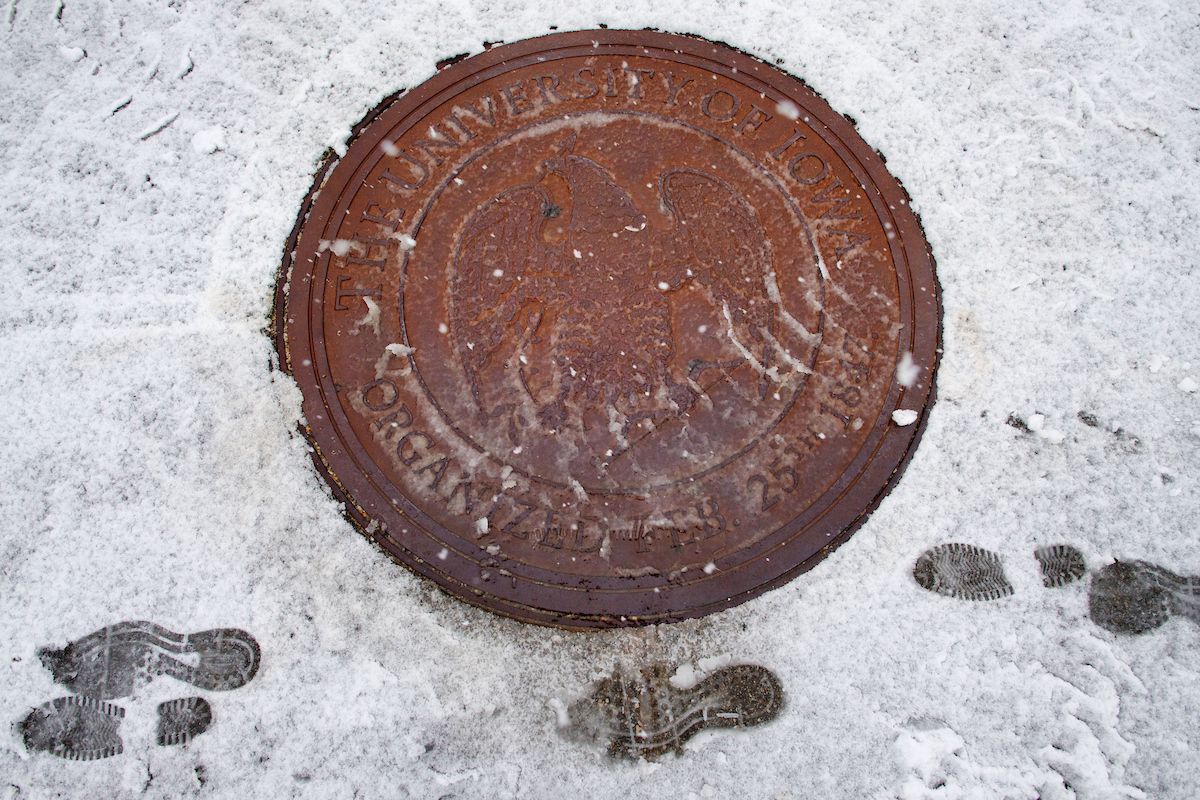 Footprints in snow next to manhole cover with UI seal
