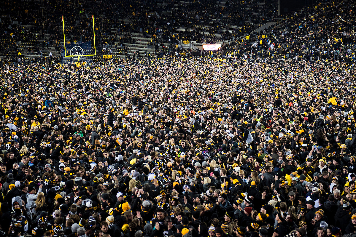 Crowd covers the field at Kinnick Stadium