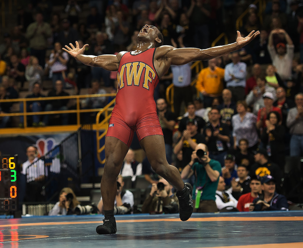 Wrestler standing with arms outstretched