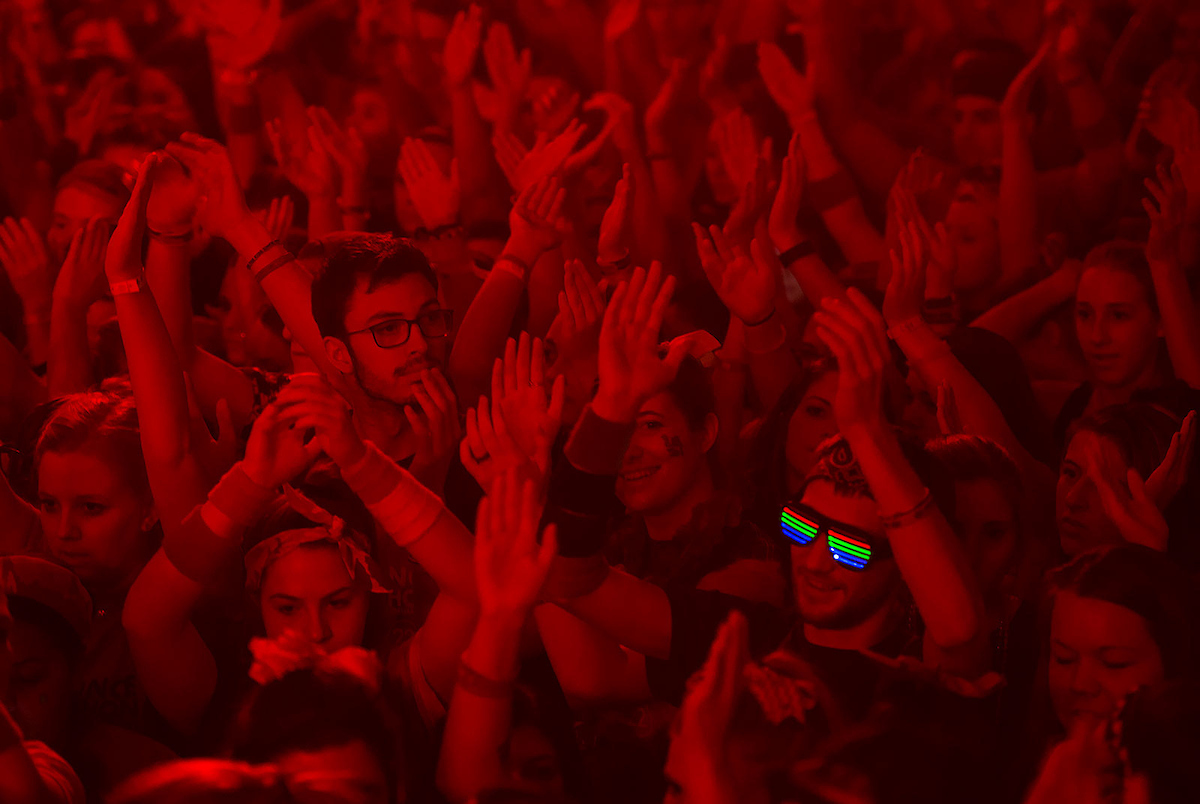 Crowd bathed in red light