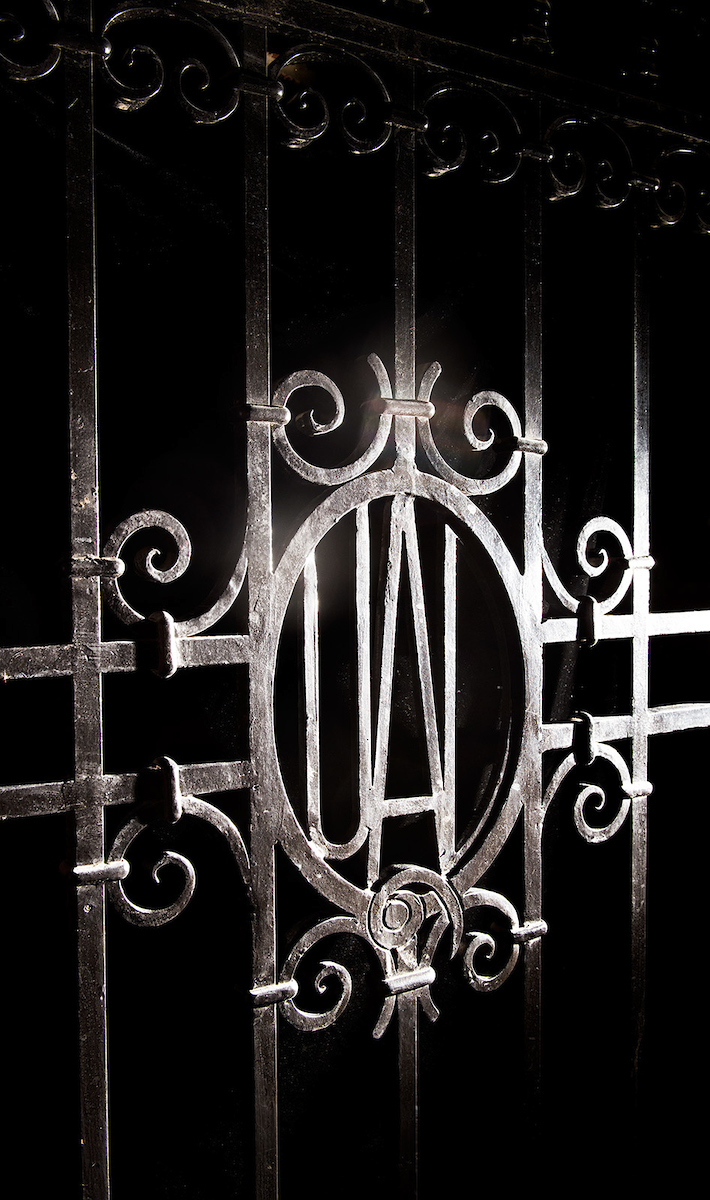 Detail of wrought-iron gate at Quadrangle Hall