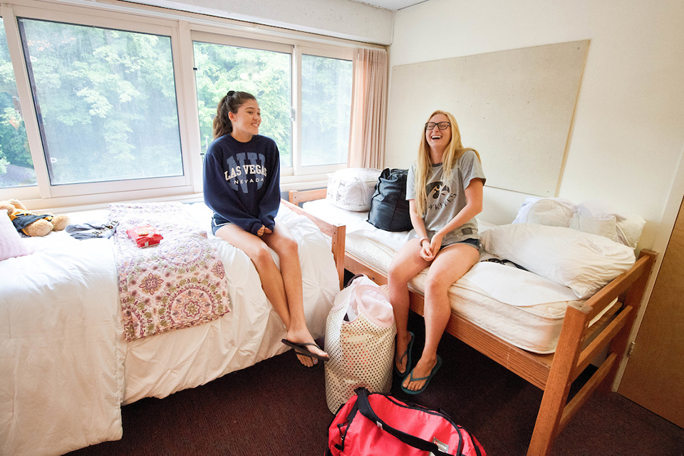 two women talking in residence hall room