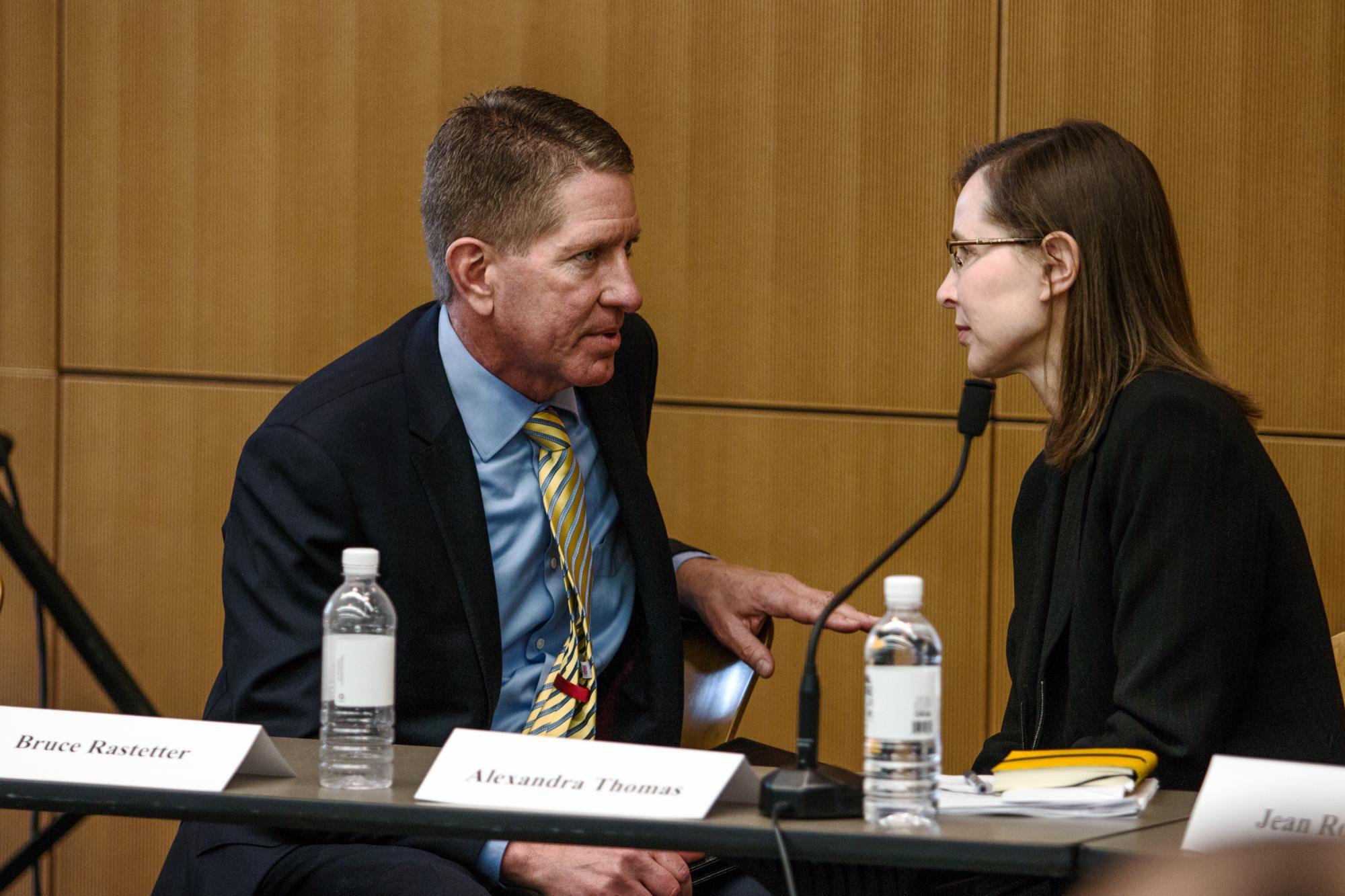 Board of Regents President Bruce Rastetter talks with UI Faculty Senate President Alexandra Thomas