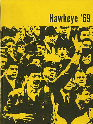 Black-and-gold cover of the 1969 Hawkeye yearbook, with a photo of a crowd and a guy flashing the peace sign