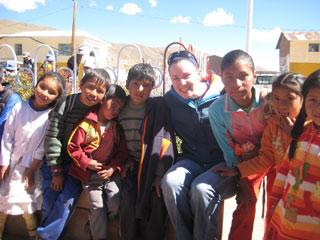 study abroad student with youth in Peru