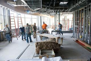 Construction works in a partially-completed room.