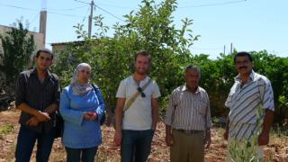 Drew Craig stands with Defence for Children International–Palestine Section lawyers (left) and two members of Iraq Burin's village council (right), a village in the north of the West Bank