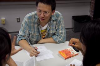 Three ESL students study together