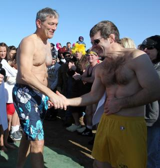 Kirk Ferentz and Tom Brands go for a freezing dip in the Iowa River