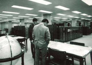 Photo of library patrons viewing maps