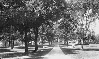 Historic photo looking toward Old Capitol from the east, with class boulders on either side of the path
