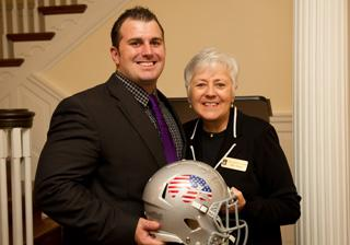 Brobston and President Mason with football helmet