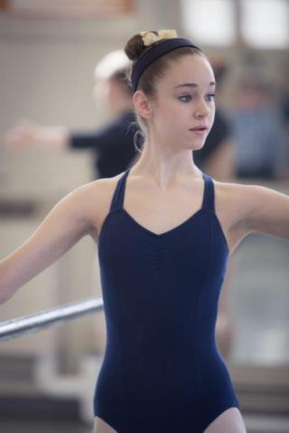 A young girl practicing ballet