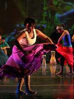 cuban dancers on stage wearing bright colors