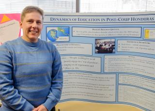 Kate Kedley and her research poster.