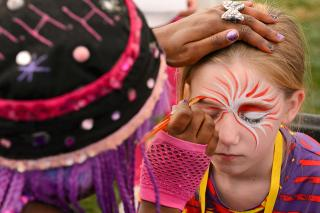 Cultural Diverity Festival 2013: A young festival participant enjoys getting her face painted by Hip Hop Hannah face painting.
