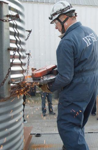 A special saw blade cuts through grain bin panels during a rescue demonstration