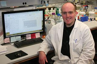 Andrew Shepherd next to a computer in lab setting