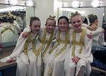 four young girls dressed as angels in dressing room