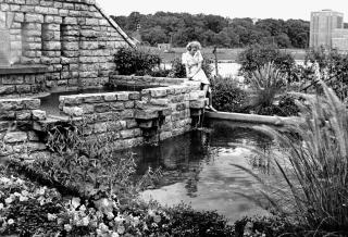 Woman sitting near fountain