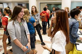 UI seniors Jade Manternach and Hyejung Kim meet for the first time during the International Buddies kickoff event on Friday, Sept. 19.
