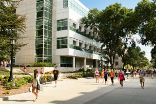 Color photo os students strolling along Cleary Walkway, with the Pomerantz Center in the background