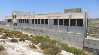 Primary school in Urif village in the north of the West Bank surrounded by cement walls