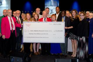 The Fraternal Order of Eagles presents a $25 million check to support the new diabetes research center at the UI.