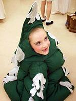 one young girls dressed as a tree in dressing room