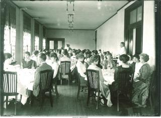 Students dining in Currier, 1910's.