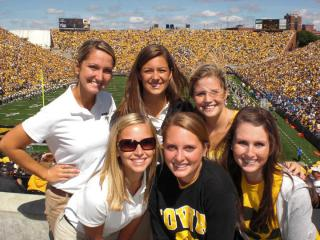 Iowa student Erica Miller poses with a friends during a football game at Kinnick Stadium.