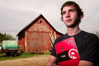 portrait of Tyler Finchum with barn in background