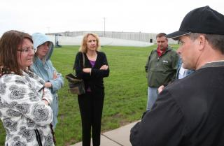 Daniel Lutat (right), program coordinator, talks about the wind-energy curriculum at Iowa Lakes Community College in Estherville during the UI Faculty Engagement Corps tour on Wednesday, May 22.
