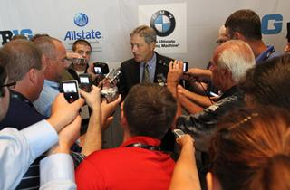 Kirk Ferentz surrounded by members of the media