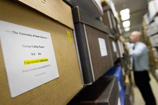 labeled boxes of Gallup's papers in library stacks