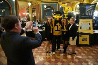 Posing for photos with Herky.