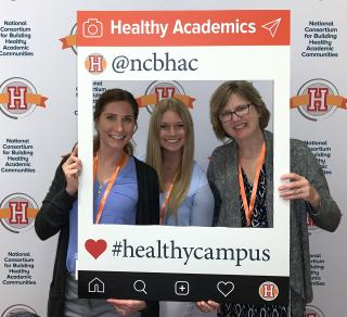 (left to right) Briana VerSteeg, behavioral health coordinator for student wellness; Mikylah Chidester (BA '19) liveWELL intern and creator of the winning video; Carla Melby, behavioral health consultant with UI wellness and University Human Resources.