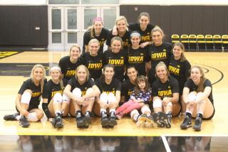 UI volleyball team with Lucy Jane Roth