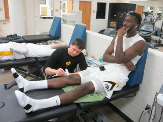 a student doing hands on athletic training