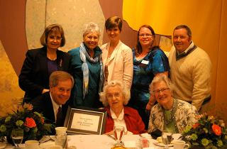Margaret Keyes in a group photo with award certificate