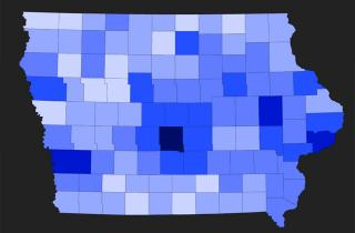 map of Iowa counties in different shades of blue to indicate foreclosure trends