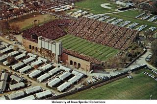 Aerial shot of temporary student housing barracks to the west of Iowa (now Kinnick) Stadium, 1963
