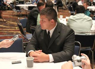 james ferentz answers questions at a table